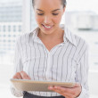 Stylish businesswoman using a tablet pc — Stock Photo