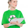Stock Photo: Thoughtful blonde activist holding clipboard