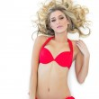 Sexy blonde model wearing red bikini looking seductively — Stock Photo #33408841