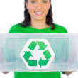 Smiling woman giving a recycling box to the camera — Stock Photo