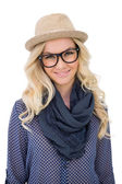 Smiling trendy blonde with classy glasses posing — Stock Photo