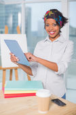 Smiling artist using tablet — Stock Photo