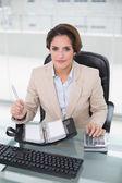 Businesswoman using calculator — Stock Photo