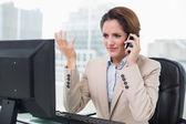 Unhappy businesswoman phoning — Stock Photo