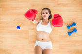 Sporty holding red boxing gloves in the air — Stock Photo
