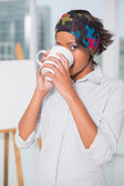 Artistic woman drinking a coffee — Stock fotografie