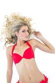 Passionate blonde model wearing red bikini — Stok fotoğraf