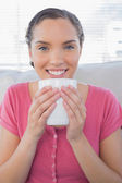 Portrait of smiling woman holding a cup of coffee — Stok fotoğraf