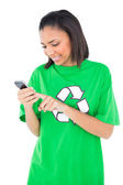 Happy environmental activist using her mobile phone — Stock Photo