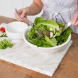 Close up on woman mixing healthy salad — Stock Photo