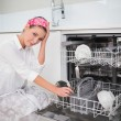 Worried charming woman using dish washer — Stock Photo