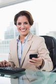 Attractive businesswoman smiling at camera — Stock Photo