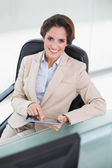 Happy businesswoman holding tablet — Stock Photo