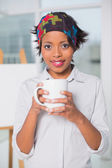 Artistic woman holding cup of coffee — Photo