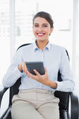 Businesswoman using a calculator — Stock Photo