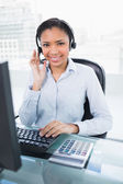 Happy young operator answering a call — Stock Photo