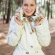 Cute woman having a walk in a forest — Stock Photo