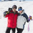 Stock Photo: Portrait of cheerful couple with ski boards on snow