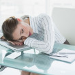 Stock Photo: Tired young businesswoman sleeping in her office