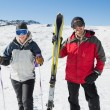Stock Photo: Portrait of smiling couple with ski equipment on snow