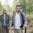 Fit young couple exploring the woods — Stockfoto #36266545