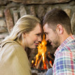 Romantic couple in front of fireplace — Stock Photo
