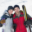 Stock Photo: Portrait of smiling couple with ski boards on snow
