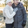 Loving young couple in winter clothing in the woods — Stock Photo