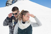 Couple in warm clothing against snowed hill — Foto de Stock