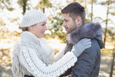 Loving couple looking at each other in winter wear outdoors — Stock Photo