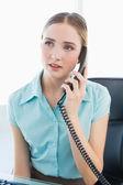 Classy thoughtful businesswoman phoning — Zdjęcie stockowe