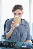 Businesswoman drinking of disposable cup — Stock Photo