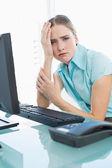 Classy upset businesswoman having a headache — Stock Photo
