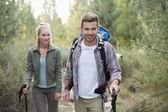 Fit young couple exploring the woods — Stock Photo