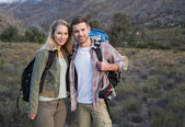 Couple with backpacks standing on forest landscape — Stock Photo