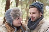 Couple in winter clothing in the woods — 图库照片