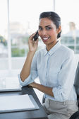 Pretty businesswoman phoning with smartphone smiling at camera — Stock Photo