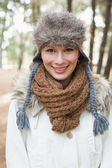 Beautiful woman wearing fur hat with woolen scarf and jacket in — Stock Photo