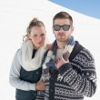 Couple in warm clothing on snow covered landscape — Stock Photo