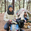 Stock Photo: Young couple camping in wilderness
