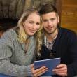 Lovely couple using tablet PC at  — Stock Photo