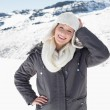 Woman in warm clothing on snowed landscape — Stock Photo