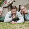 Young couple camping in the wilderness — Stock Photo