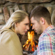 Romantic young couple in front of fireplace — Stock Photo