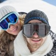 Close-up of a couple in ski goggles against snow — Stock Photo