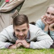 Постер, плакат: Young couple camping in the wilderness