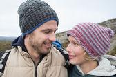 Loving couple on a hike in the countryside — Stockfoto