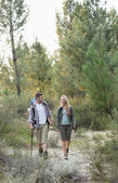 Full length of a fit couple exploring the woods — Stock Photo