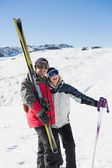Cheerful couple with ski boards on snow — Stock Photo