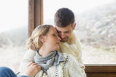 Close-up of a loving young couple in winter clothing — Stock Photo